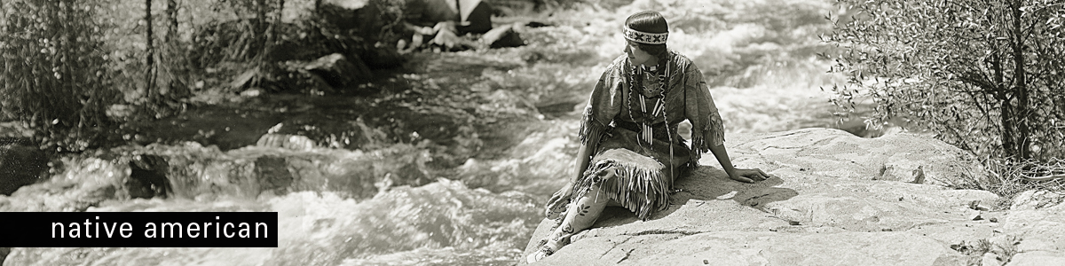 Afton Press - Native American woman sitting next to river