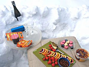 of champagne and snacks for an outside gathering